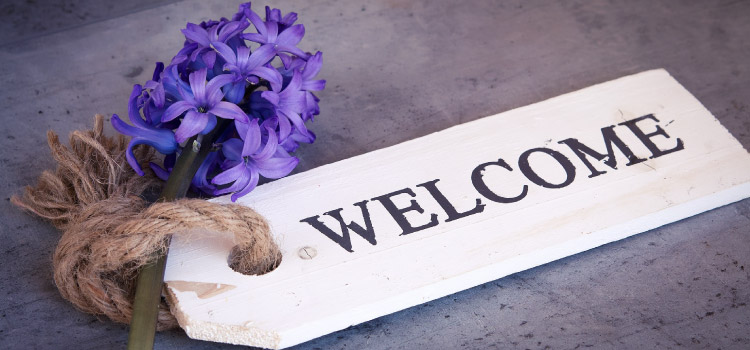 wooden welcome sign tied to hyacinth
