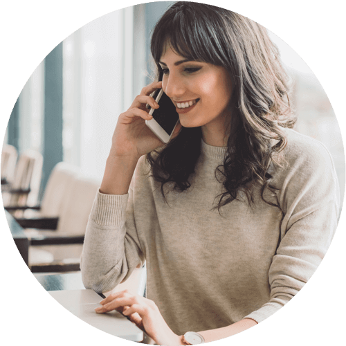 A woman talking on the phone about her flexible financial options for porcelain veneers