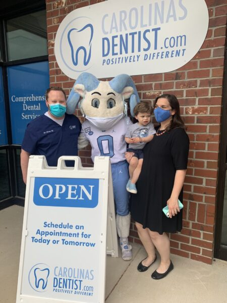 Dr. Zukerman and his family were face masks while posing with Rameses the UNC mascot outside CarolinasDentist in Chapel Hill, NC