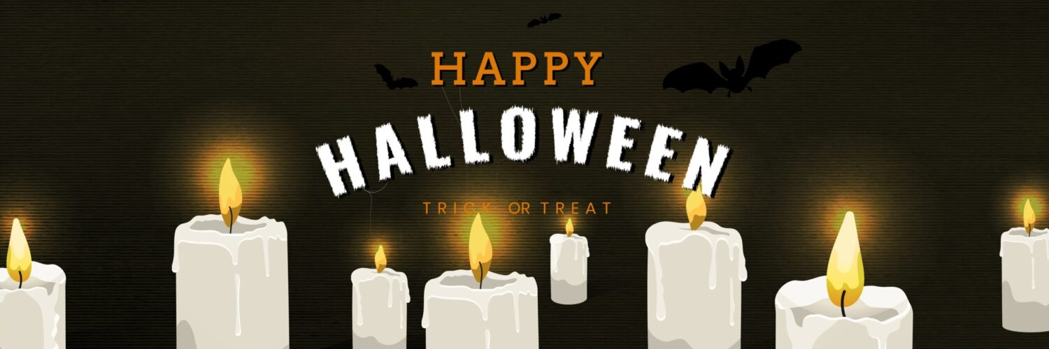 Happy Halloween Text On A Black Background With Lit Candles